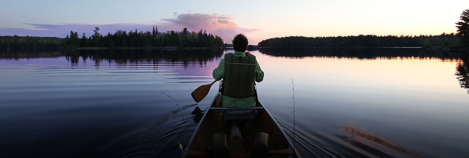 Man in canoe at sunset